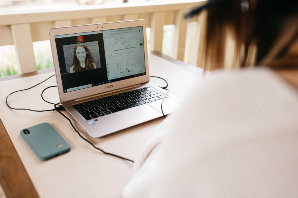 Emergent Education Teacher Ana teaches via BitPaper and Zoom Math Homework for Student on laptop